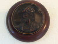 An Edwardian plaster composition wall plaque