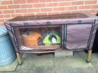 Guinea pig or rabbit hutch with cover - ideal for two guinea pigs or one rabbit.
