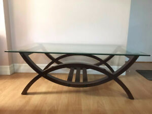 Glass top wooden frame coffee table