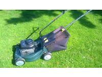 small plastic body lawnmower (like new)