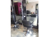 Salon mirrors and styling chairs