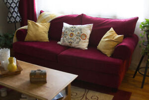 Red couch (purchased 18 months ago) in excellent condition