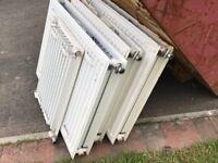 3 80cm x 60cm double radiators and 1 40cm x 60cm single radiator