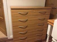 Light oak veneer large chest of drawers.