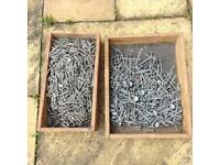 Lot of galvanised umbrella nails and galvanised fixing staples.