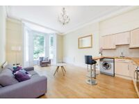 A two double bedroom flat with high ceilings and wooden floors moments from Westfield & Central line