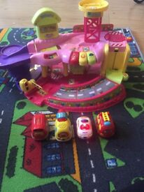Pink toot toot garage and 4x cars