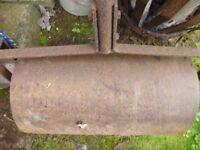 Heavy cast iron garden roller, with cast iron handle.