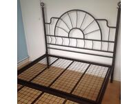 Double bed frame with attachments to enable 4 poster bed.