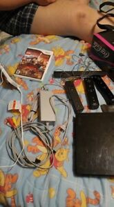 Nintendo wii with 4 games and 3 controllers