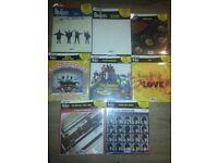 8 Beatles albums mint still all sealed.