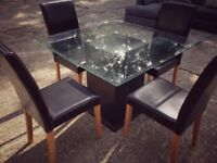 Glass dining table with four leather chairs - great condition
