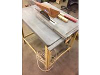 Table saw with sliding table carriage extension