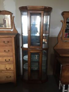 Upright piano and curio cabnit