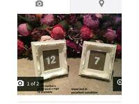White beautiful vintage filigree ornate photo frame table numbers wedding event burlap rustic