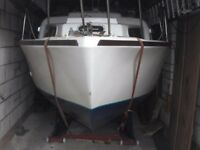 a 18 foot bilge keels yacht that can be stored in your garage with self loading/ off loading trailer