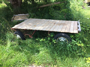 Small old hay trailer newer deck 250