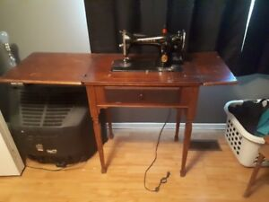 Singer Sewing machine moutned in sewing table