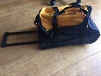 Orange & black Puffle pull along duffle bag