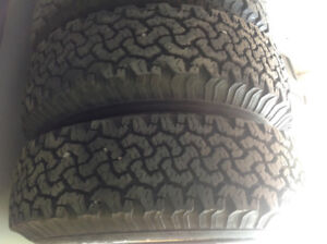 235/85R16 tires on wheels. See ad for price and details.