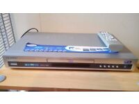 Samsung DVD Player E235D and remote control.