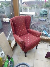 Rust coloured winged armchair