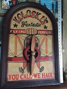 This wooden sign 1960 Koloskis flying services