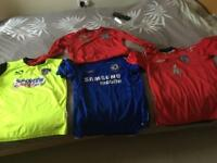Assorted football tops