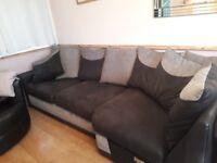 Large sofa / corner suite, cushion backed design in black / grey