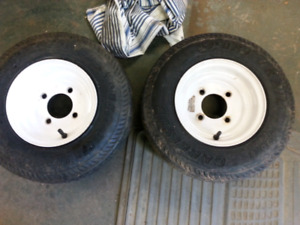 Two new tires and rims for utility trailer for sale