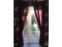 A pair of Plum/Purple curtains with Tie backs