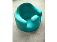Bumbo infant support - Keeps baby sat comfortably upright.