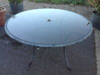 Lovely glass topped metal framed garden table with hole for parasol - very good condition -