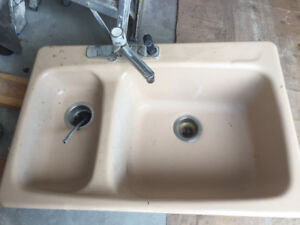 cast iron kitchen sink with faucets
