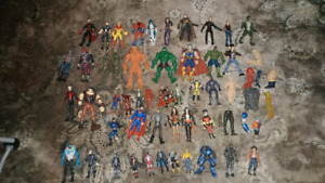 Assorted action figures, funko pop vinyl figures, random stuff