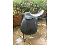 Saddle, full size leather bridle, martingales, bits, children's riding hats and jodhpurs boots,
