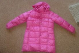 pink padded girls coat with hood that can be tucked into zip area on collar size 9-10yrs