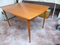 Dining table and chairs. Robust, attractive mahogany table, 4 matching chairs. Table is storeable.