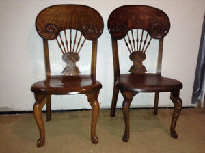 Two wood antique wood chairs