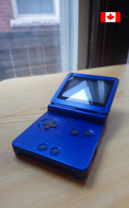 Game Boy Advance SP with Pokemon, charger and headphone adapter