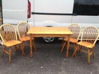 Solid pine table and 4 chairs.