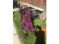 Purple pushchair
