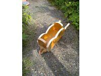 Small home made wheel barrow planter / holder