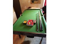Quarter size foldaway snooker table with accessories