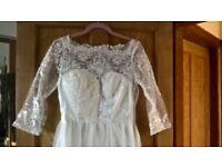 Unworn wedding dress size 10