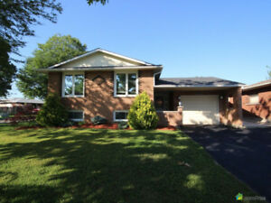 Newly renovated, clean, solid brick 3+1 bedroom raised bungalow