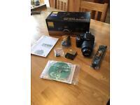 Nikon D5100 DSLR camera with 18-55mm lense