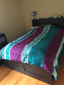 comforter with two pillow shams, matching bedskirt and
