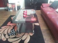 """coffee table black and glass top & shelf with chrome legs. 34""""x24"""" cost £65. sell £30"""