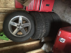 Used rims and tires of a dodge ram